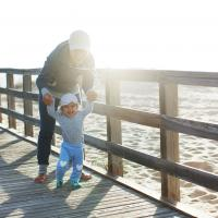 Au pair with child at the sea